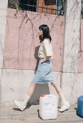 How to Wear a Light Blue Denim Pencil Skirt: For a cool-meets-classy outfit, consider teaming a white short sleeve button down shirt with a light blue denim pencil skirt — these pieces fit really well together. For times when this getup is too much, tone it down by rounding off with white athletic shoes.
