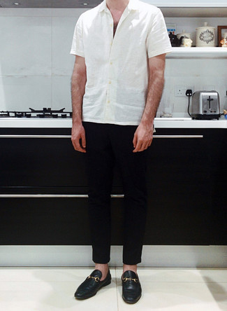 Black Chinos Outfits: Pair a white short sleeve shirt with black chinos to assemble a daily look that's full of charm and character. For something more on the elegant end to complete your getup, complete this outfit with a pair of black leather loafers.