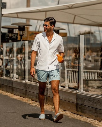 How to Wear Light Blue Shorts For Men: For something more on the casual and cool end, you can rely on a white short sleeve shirt and light blue shorts. Our favorite of a countless number of ways to round off this getup is a pair of light blue canvas espadrilles.