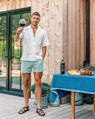 White Short Sleeve Shirt Outfits For Men: Try pairing a white short sleeve shirt with mint shorts for a stylish, relaxed outfit. When this getup looks all-too-perfect, tone it down by slipping into a pair of black leather sandals.