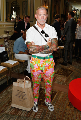 Nick Wooster wearing White Short Sleeve Shirt, Multi colored Floral Chinos, Black and White Check Canvas Slip-on Sneakers, Green Canvas Belt