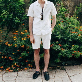 Men's Outfits 2020: This combo of a white short sleeve shirt and white shorts is irrefutable proof that a pared down off-duty look doesn't have to be boring. Take this outfit a more elegant path by finishing with black leather loafers.