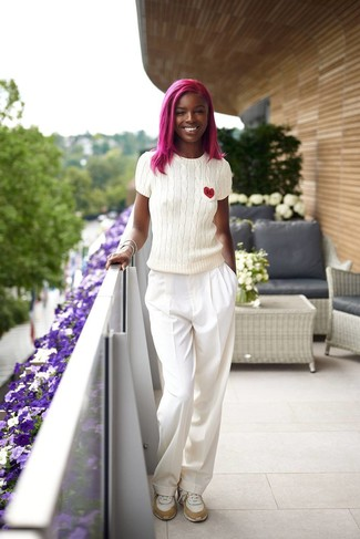 How to Wear White Wide Leg Pants: A white short sleeve sweater and white wide leg pants are the kind of uber chic casual pieces that you can wear for years to come. A pair of white athletic shoes effortlesslly ramps up the wow factor of your look.