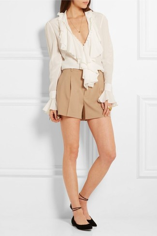 Try teaming a Boohoo Ruffle Tie Neck Blouse with tan shorts for both chic and easy-to-wear look. Dress down your look with black suede ballerina shoes. You're guaranteed to always look totally chic even despite the scorching heat if you keep this outfit in your front hall closet.