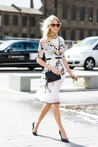 Dress in white floral fit and flare dress for a Sunday lunch with friends. Black leather pumps will bring a classic aesthetic to the ensemble.