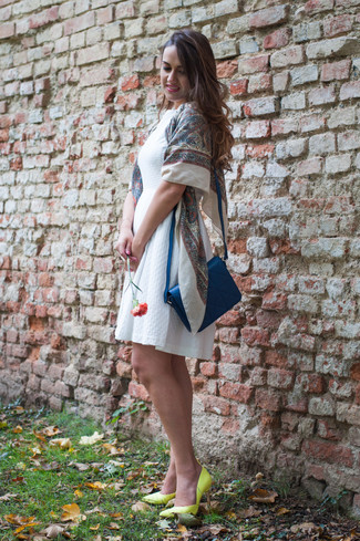 How to Wear a Blue Leather Crossbody Bag In Warm Weather: A white skater dress and a blue leather crossbody bag matched together are a total eye candy for ladies who prefer relaxed styles. Green-yellow leather pumps are the most effective way to transform your outfit.