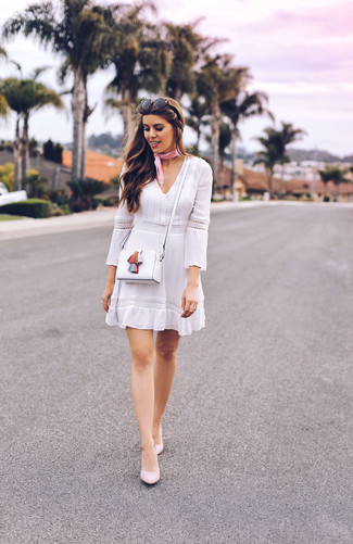 Reach for a white crochet skater dress for an effortless kind of elegance. Play down the casualness of your outfit with Forever 21 Pointed Faux Suede Pumps. Totally appropriate for super hot summertime afternoons, you can sport this ensemble throughout the summer season.