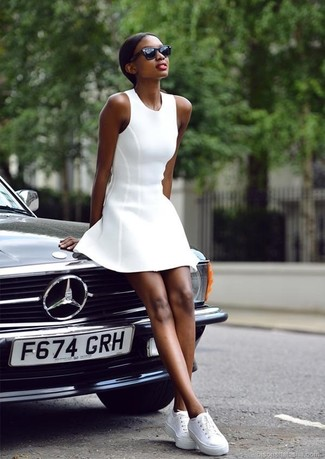 How to wear: white skater dress, white low top sneakers, black sunglasses