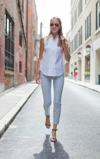 How to wear: white sleeveless button down shirt, light blue skinny pants, black leather heeled sandals