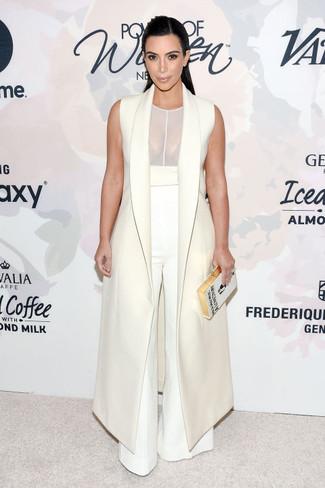 Kim Kardashian wearing White Sleeveless Coat, White Mesh Tank, White Wide Leg Pants, White Embroidered Clutch