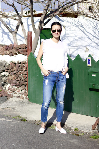 Women's White Sleeveless Top, Blue Ripped Jeans, White Leather Loafers, Black Sunglasses