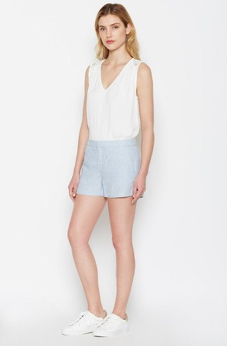 How to wear: white sleeveless top, light blue shorts, white leather low top sneakers