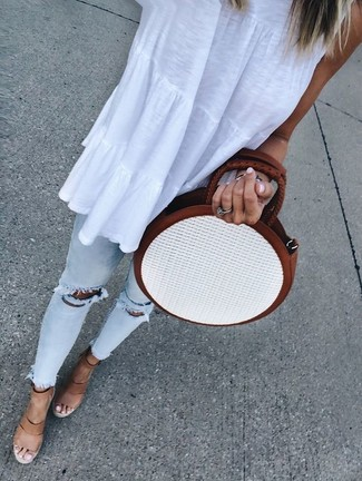 How to wear: white sleeveless top, light blue ripped skinny jeans, tan leather wedge sandals, white straw crossbody bag
