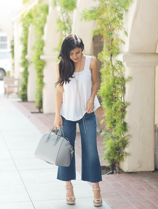 How to Wear Navy Denim Culottes: This relaxed pairing of a white sleeveless top and navy denim culottes is super easy to pull together without a second thought, helping you look chic and prepared for anything without spending a ton of time rummaging through your wardrobe. And it's a wonder how a pair of beige leather wedge sandals can upgrade a look.