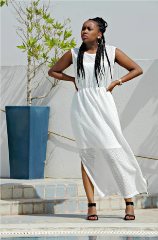 Rock a white slit maxi dress to create a great weekend-ready look. Black and tan leather heeled sandals will instantly smarten up even the laziest of looks. We love how ideal this look is come roasting hot sunny days.