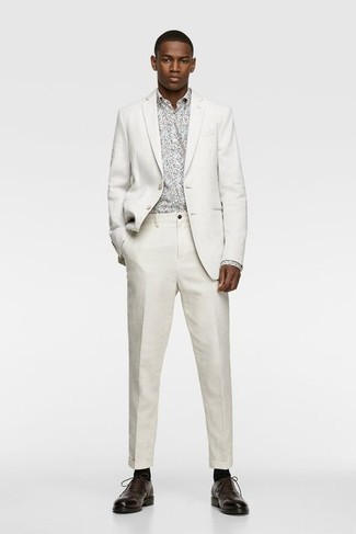 Socks Outfits For Men: Wear a white suit and socks if you wish to look neat and relaxed without making too much effort. Our favorite of an infinite number of ways to finish this outfit is a pair of dark brown leather oxford shoes.