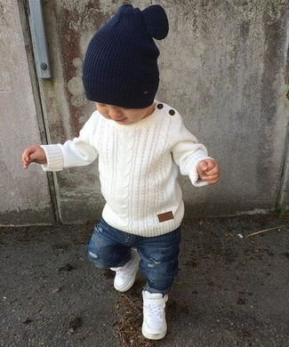 This combo of a white sweater and blue ripped jeans is both a comfortable and stylish choice for your son. For footwear opt for a pair of white sneakers.
