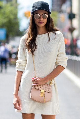 How to wear: white sweater dress, beige leather crossbody bag, black cap, gold sunglasses