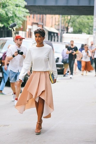 How to wear: white sweatshirt, beige pleated midi skirt, beige leather heeled sandals, black print clutch