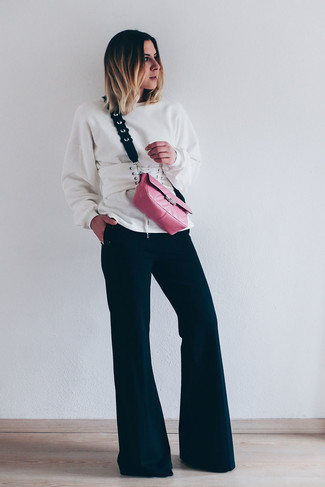 How to wear: white sweatshirt, black flare pants, hot pink leather crossbody bag, white leather waist belt