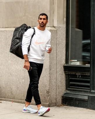 How to wear: white print sweatshirt, black jeans, white athletic shoes, black canvas duffle bag
