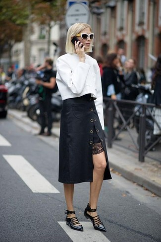 A white sweatshirt and a Rag & Bone Phoebe Back Zip Midi Skirt are absolute staples if you're planning a casual wardrobe that matches up to the highest fashion standards. Black leather ballerina shoes will add some edge to an otherwise classic ensemble. As you can see, it's a knockout, not to mention season-appropriate, outfit to keep in your seasonal rotation.