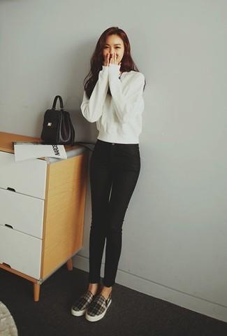 How to wear: white sweatshirt, black skinny jeans, black and white plaid slip-on sneakers, black leather satchel bag