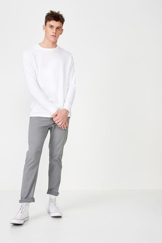 How to wear: white sweatshirt, grey chinos, white canvas high top sneakers