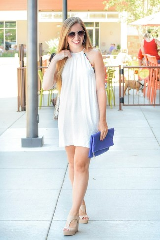 White Swing Dress Outfits: If you're looking to take your casual look up a notch, reach for a white swing dress. Complete your ensemble with beige leather wedge sandals and you're all done and looking amazing.