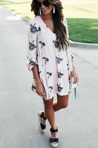 Reach for white floral swing dress to effortlessly deal with whatever this day throws at you. Mix things up by wearing black espadrilles.
