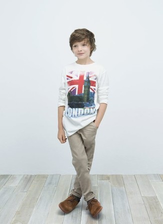 How to Wear Tan Trousers In Hot Weather For Boys: For an everyday outfit that is full of character and personality go for a white t-shirt and tan trousers for your tot. This getup is complemented brilliantly with brown oxford shoes.