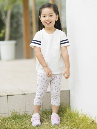 How to Wear Grey Print Leggings For Girls: Suggest that your little princess pair a white t-shirt with grey print leggings for a fun day in the park. This outfit is complemented really well with pink sneakers.