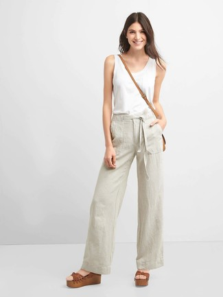 How to wear: white tank, beige wide leg pants, brown leather wedge sandals, tan leather crossbody bag