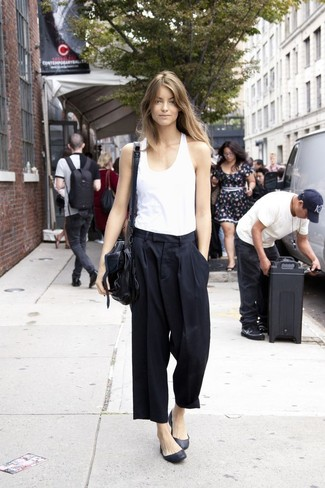 Make a white tank and black culottes your outfit choice for an easy to wear look. This ensemble is complemented perfectly with black leather ballerina shoes. What an exciting idea for warm weather!