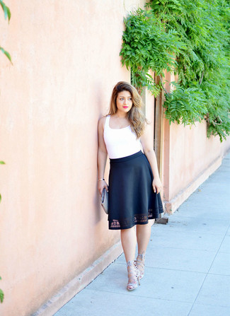 If you're a jeans-and-a-tee kind of gal, you'll like the simple combo of a white tank and a black full skirt. Take a classic approach with the footwear and rock a pair of grey suede heeled sandals.