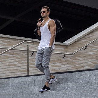 How to wear: white tank, grey sweatpants, grey athletic shoes, dark brown leather holdall