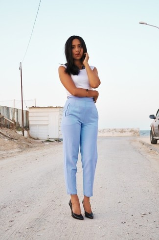If you're on the hunt for a casual yet totally stylish ensemble, consider teaming a white tank with light blue dress pants. Both pieces are totally comfy and will look fabulous together. Rock a pair of black leather pumps to instantly up the chic factor of any outfit.
