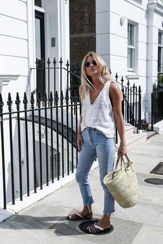 Tan Straw Tote Bag Outfits: For comfort dressing with a twist, team a white tank with a tan straw tote bag. Bump up the cool of your look by rounding off with a pair of multi colored leather flat sandals.