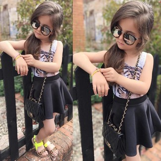 How to Wear a Black Skirt For Girls: Choose a white tank top and a black skirt for your little angel for a fun day in the park. Finish this look with green-yellow sandals.