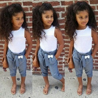 Girls' Looks & Outfits: What To Wear In Summer: Suggest that your daughter pair a white tank top with light blue trousers for a comfy outfit. This style is complemented perfectly with brown sandals.
