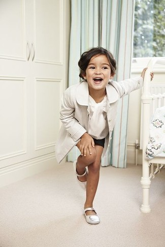 Let your little fashionista perfect the smart casual look in a white trench coat and black shorts. And why not add white ballet flats to the mix?