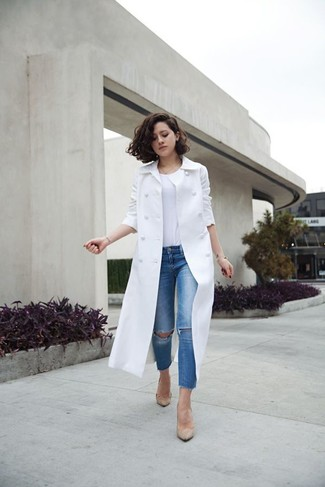 Master the effortlessly chic look in a white trench coat and blue distressed slim jeans. To add oomph to your ensemble, complete with beige leather pumps. We love that this combo is ideal come spring.