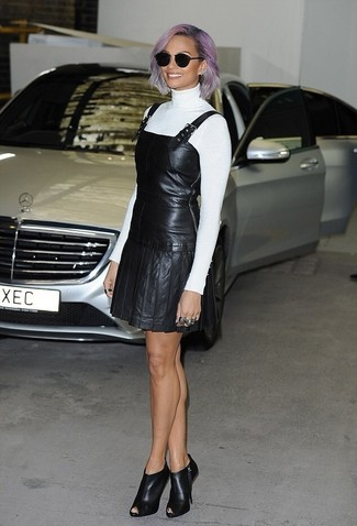 How to wear: white turtleneck, black leather overall dress, black cutout leather ankle boots