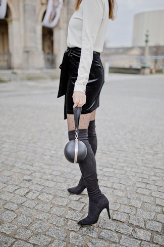 How to wear: white turtleneck, black velvet mini skirt, black suede over the knee boots, black leather clutch