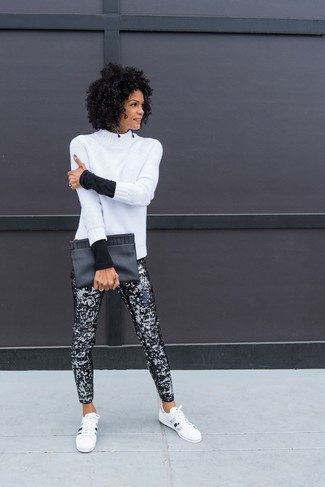 If you feel more confident wearing something comfortable, you'll fall in love with this absolutely chic pairing of a white knit wool turtleneck and black sequin skinny pants. Choose a pair of white and black leather low top sneakers for a more relaxed aesthetic. With springtime in the air, it's time to make space for simple and stylish outfits, just like this.