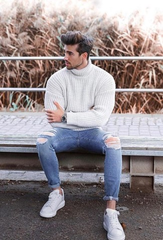 Consider wearing a white knit turtleneck and blue ripped skinny jeans, if you want to dress for comfort without looking like a slob. A cool pair of white leather low top sneakers is an easy way to upgrade your look. When spring is in the air, you'll love this getup as your uniform for winter-to-spring weather.