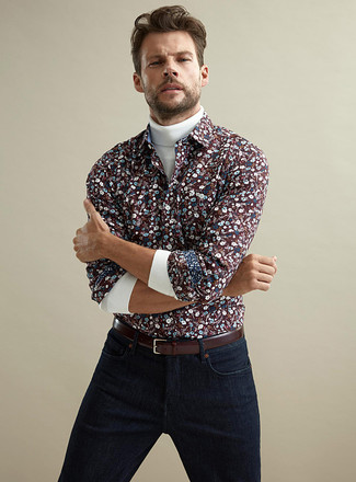 How to Wear a Floral Shirt For Men: Teaming a floral shirt with navy jeans is an on-point choice for a casual ensemble.