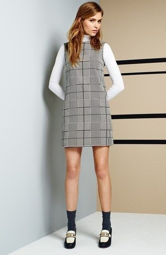 How to wear: white turtleneck, grey plaid shift dress, white and black leather loafers, charcoal socks