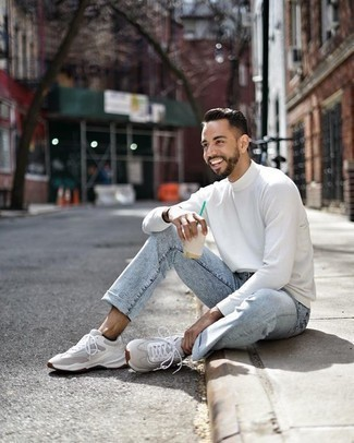 How to Wear Grey Athletic Shoes For Men: Wear a white turtleneck and light blue acid wash jeans for relaxed dressing with a modern finish. Spice up this look by finishing off with grey athletic shoes.