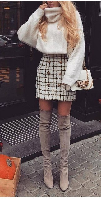 For comfort without the need to sacrifice on style, we love this combination of a white knit wool turtleneck and a Jimmy Choo Small Riley Leather Crossbody Bag White. Consider grey suede over the knee boots as the glue that will bring your look together. Mastering transitional fashion is easy with style inspo like this.